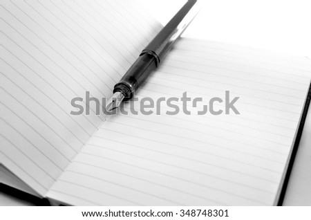 Fountain Pen on a notebook. - stock photo