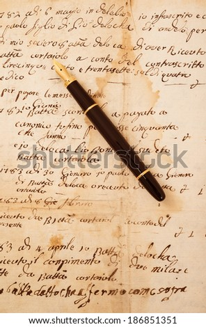 Fountain pen on an antique  letter - stock photo