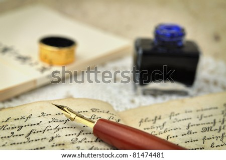Fountain pen on an old diary - stock photo