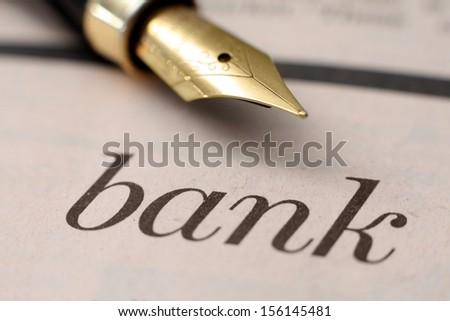 Fountain pen on bank text - stock photo