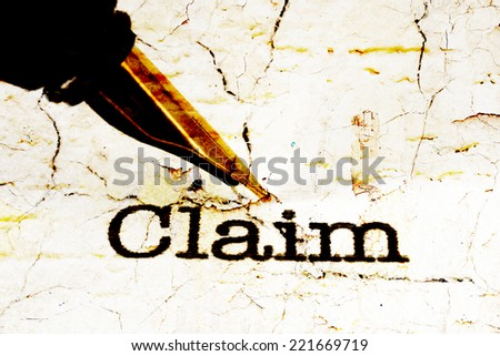Fountain pen on claim text - stock photo