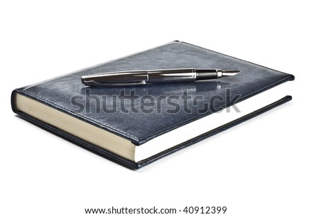 fountain pen on diary isolated on white - stock photo