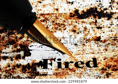 Fountain pen on fired text - stock photo