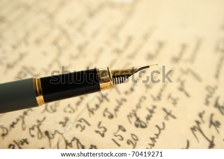 Fountain pen on old letter - stock photo