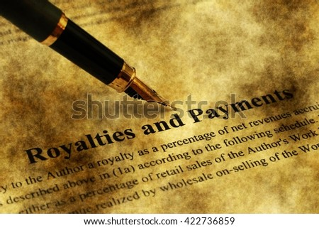 Fountain pen on royalties and payments form - stock photo