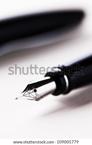 fountain pen on table - stock photo