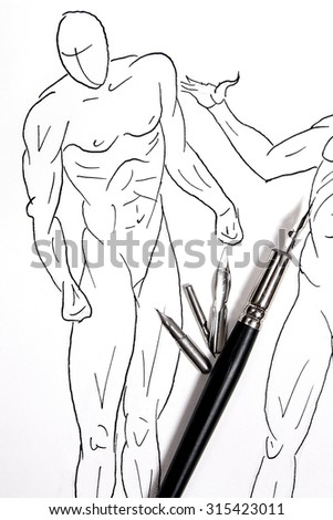 Fountain pen with original drawing on background. Fountain pen and different kinds of metal nib pen.  - stock photo