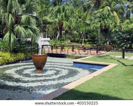 Fountain Pool in a Lush Garden of Malaysia - stock photo