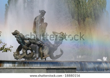 fountain sculpture with water and rainbow