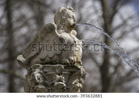 fountain shaped figure angel water jets coming out of breasts and mouth, spring in Spain