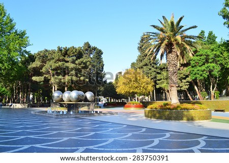 Fountain Square in Baku, Azerbaijan. . Sitting and walking on Fountain Square - a favorite occupation of Baku residents. - stock photo