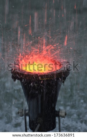 Fountain water falling on orange color light, a perfect shot for backgrounds, backdrops - stock photo