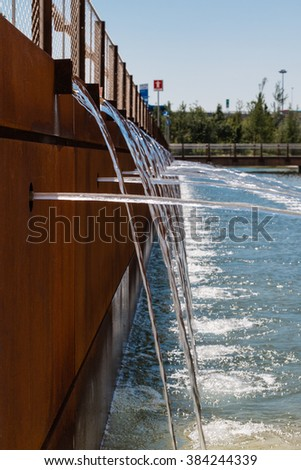 Fountain: Water flowing Out From Multiple Pipes - stock photo