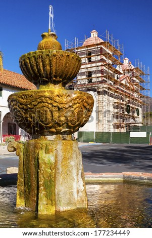 Fountain White Adobe Mission Santa Barbara Construction California.  Founded in 1786 at the end of Father Junipero Serra life. - stock photo