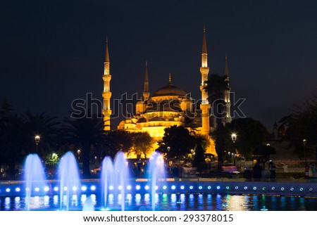 fountain with blue illumination on Sultanahmet square in front of the Blue mosque (Sultan Ahmed Mosque)in Istanbul in the evening - stock photo