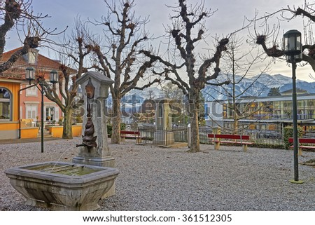 Fountain with Drinking water in the Old City of Thun Embankment. Thun is a city in Swiss canton of Bern, where Aare river flows out of Lake Thun. Town Hall Square is a historic center of the city