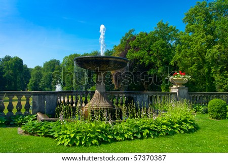 fountain with flowers in park Sanssouci, Potsdam, Berlin - stock photo