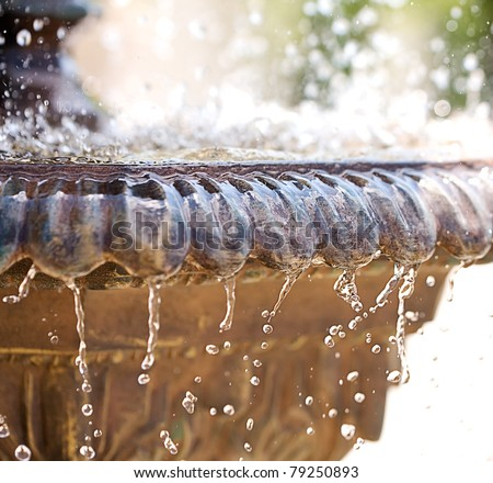 Fountain with high shutter speed to freeze water drops in air - stock photo