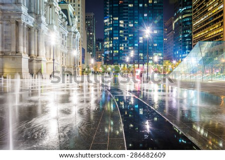 Fountains and buildings at night, at Dilworth Park, in Philadelphia, Pennsylvania. - stock photo