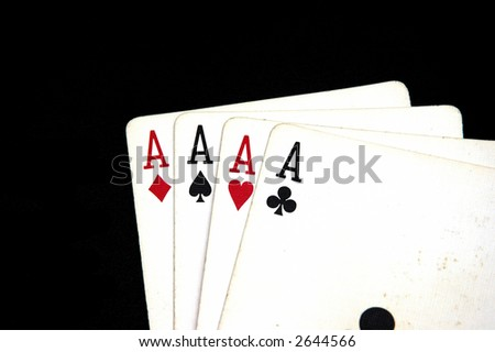 Four Aces against a black back ground - stock photo