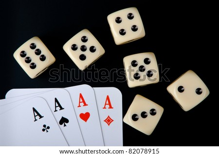 Four aces and five dices on black background - stock photo