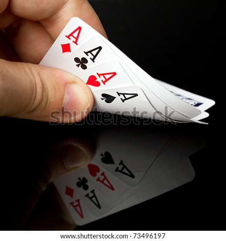 Four aces in the hand with reflection - stock photo