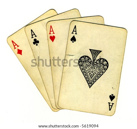 Four aces (isolated from the background with a clipping path), old used cards - stock photo
