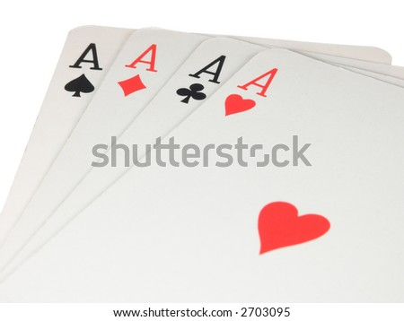 Four aces of a pack of cards taken close over white - stock photo