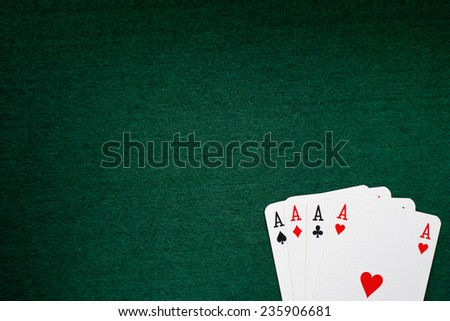 Four aces on a green background. - stock photo