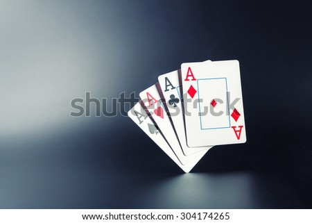 Four aces on grey - stock photo