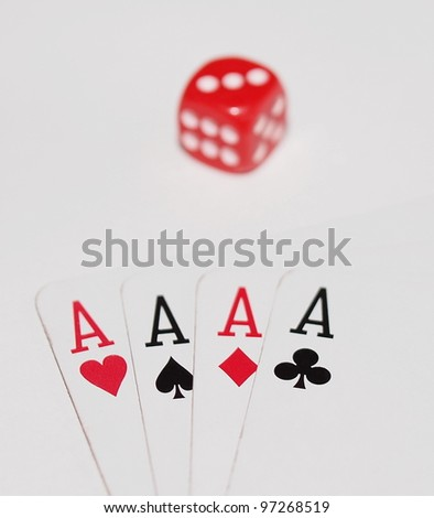 Four aces playing cards and red dice isolated on white background - stock photo