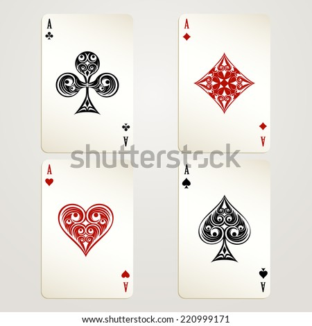 Four aces playing cards designs showing each of the four suits in red and black conceptual of a casino and gambling