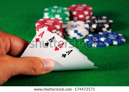 Four aces poker hand - stock photo