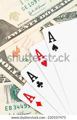 Four aces poker playing card on dollar banknote
