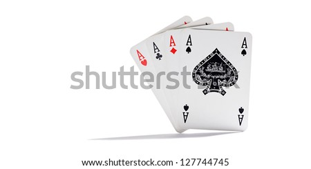 Four aces representing the four suits in playing cards standing upright and fanned on a white background with copy space conceptual of gambling and casinos - stock photo
