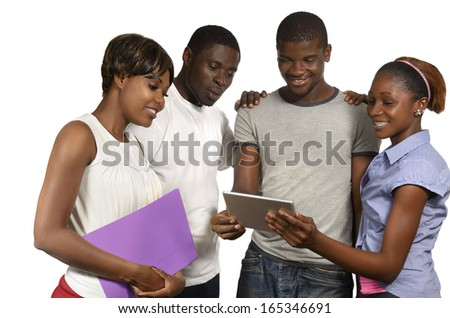 Four african friends looking at tablet PC, Studio Shot