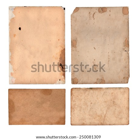 Four aged and damaged pieces of paper - stock photo
