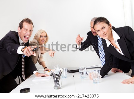 Four angry business people screaming at camera - stock photo