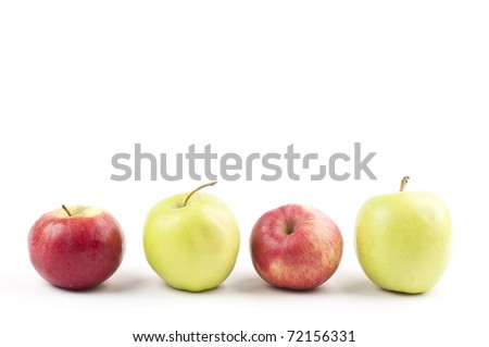 Four apple in a row on white