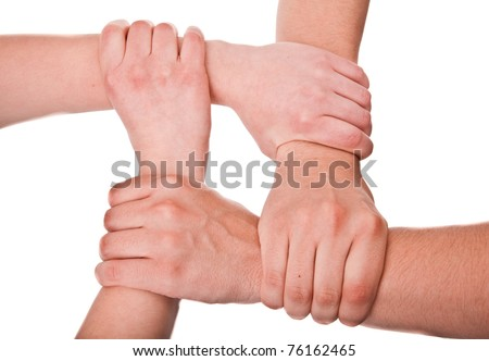 Four arms crossed and holding each other - stock photo