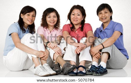 Four Asian women sitting together - stock photo