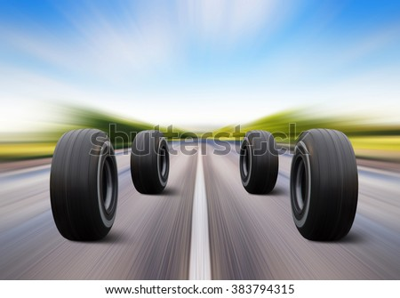 four automobile wheels rush on the road with high speed - stock photo