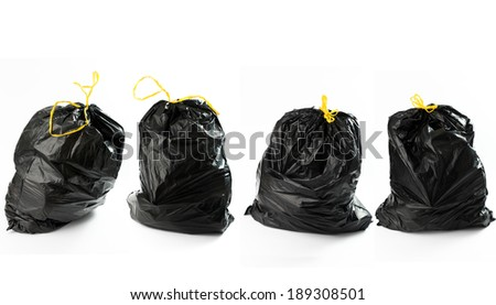 Four bags of garbage disposed frontally - stock photo