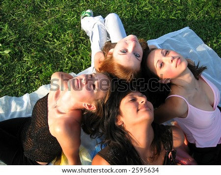Four beautiful girls on the grass