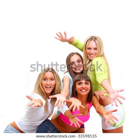 Four beautiful happy young women with a smile in bright multi-coloured clothes - stock photo