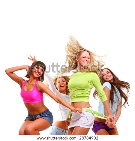 Four beautiful happy young women with a smile in bright multi-coloured clothes, isolated on a white background