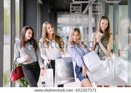 Four Beauty Girls Walking And Shopping At The Mall