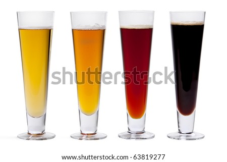 Four beers in glasses arranged by color against white background.