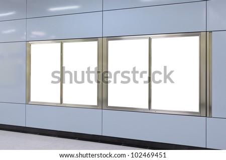 Four big vertical / portrait orientation blank billboard on modern blue wall - stock photo
