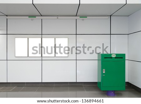 Four big vertical / portrait orientation blank billboard on wall with mail box in public open space - stock photo